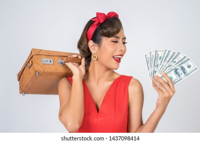 Retro fashion women hand take a luggage and dollar money to travel