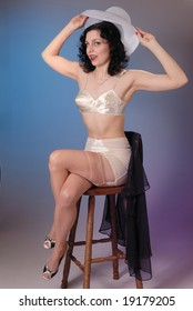 c599b641a9 Retro fifties pin-up attractive girl in vintage lingerie on colorful  background - pin-