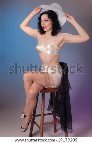b3e1d9997cb Retro fifties pin-up attractive girl in vintage lingerie on colorful  background - pin-