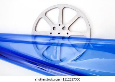 retro film reel on blue