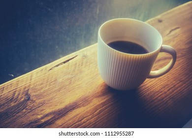 Retro Filtered Cup Of Hot Black Coffee In A Hipster Cafe