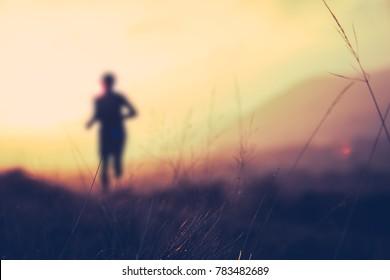 Retro Filtered Fitness Training Hill Runner At Sunset