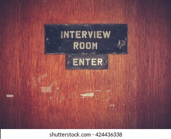 Retro Filtered Image Of A Grungy Interview Room Door