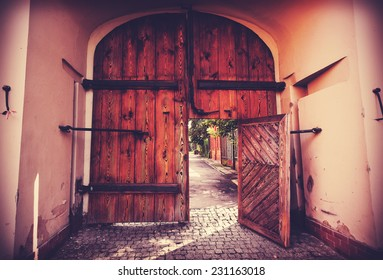 Retro filtered picture of old wooden gate.