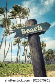 Retro Filtered Rustic Sign On A Windswept Beach With Palm Trees In Hawaii