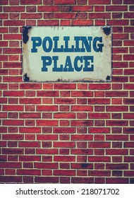 Retro Filtered Sign For An Election Polling Place Or Station On A Red Brick Wall