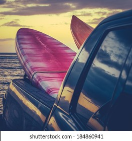 Retro Filtered Style Surfboards In A Truck At Sunset In Hawaii