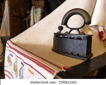 Retro flat iron on white textil