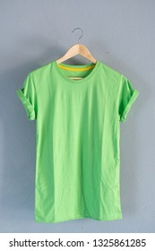 Retro fold green cotton T-Shirt clothes mock up template on gray