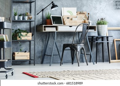 Retro furniture, rack, cart, lamp and desk in office room