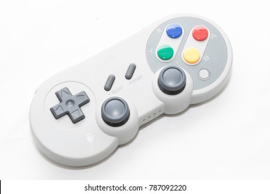 A Retro gamepad controller on white background