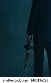 Retro gangster holding machine gun.