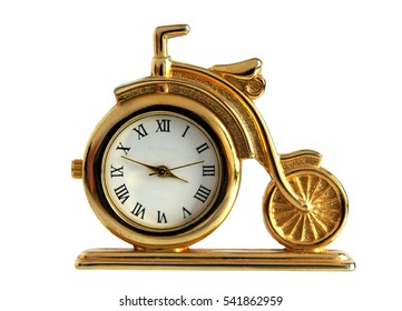 Retro gilded table clock Bicycle isolated on white background