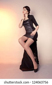 retro girl in a black dress and lace on the forehead