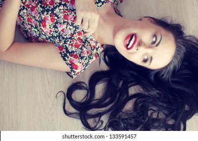 retro girl is lying on the floor. vintage photo