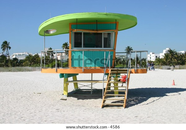 retro green, blue and orange lifeguard shack
