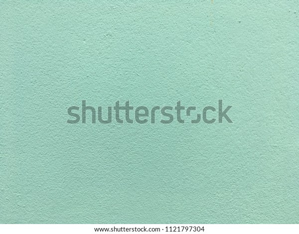 Retro green cement wall background for texture