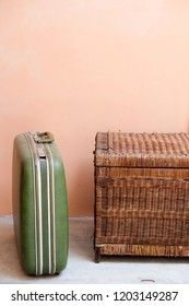 retro green suitcases with Old wooden chest