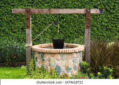 retro groundwater well in garden