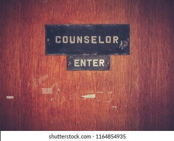 Retro Grungy Counselor's Office Door At A Public School Or University