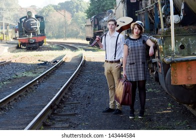 Retro hip hipster romantic love couple in vintage train setting