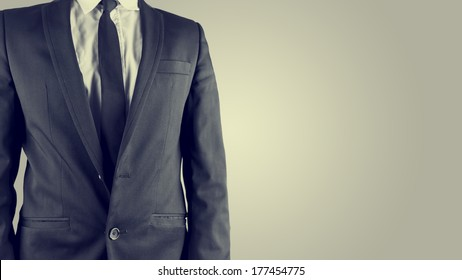 Retro image of a businessman in a classic stylish linen suit with a white shirt and necktie, isolated torso view with copyspace.