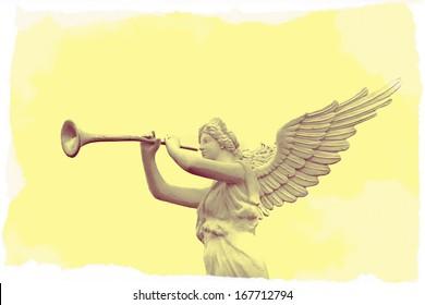 Retro image of trumpeting golden music angel statue