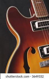 Retro jazz style semi-hollow body electric guitar