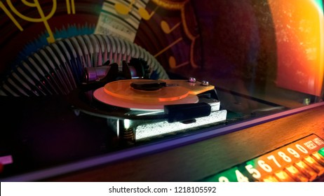 Retro jukebox turntable closeup, old-fashion party entertainment, music device