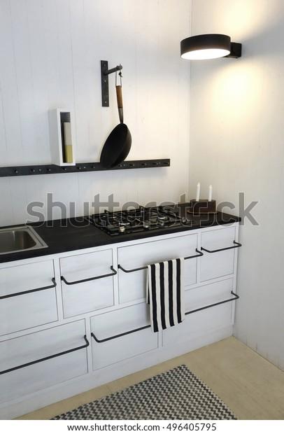 Retro Kitchen in bright white colors. Minimalistic, sparse and contemporary interior design.