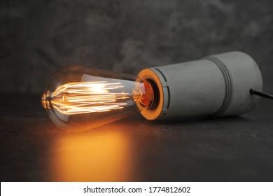 Retro lamp with Edison lamp on concrete. A good idea
