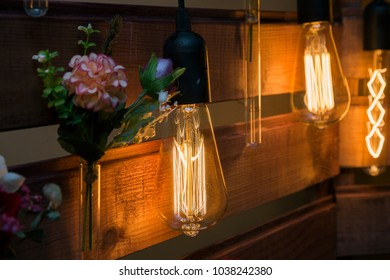retro lamp on a background of wood and flowers