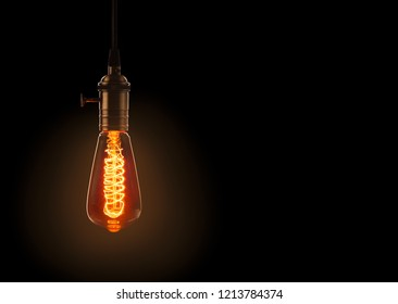 retro light bulb on dark background with space