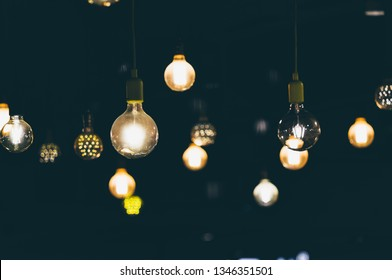 Retro light bulbs hanging in department store, with decorate interior luxury, fixtures combine beautiful modernity Designer, lamps on the ceiling, beautifully laid out.