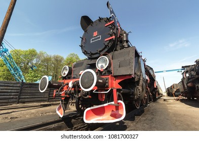 retro locomotive on blue sky background