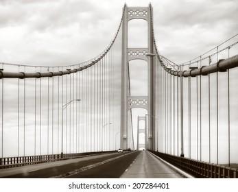 Retro Mackinac Bridge steel, metal suspension bridge in Michigan USA in sepia
