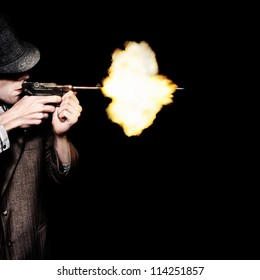 Retro Male Gangster Shooting Old Fashioned Pistol On Black Background