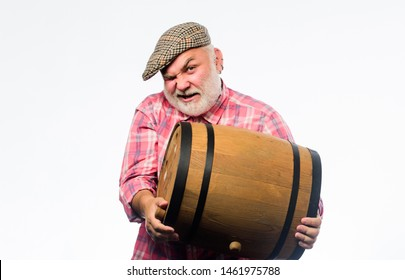 Retro man with a beer barrel. Barman. wooden barrel. oktoberfest festival. brewery for maturing alcohol. Homemade wine. Man bearded senior carry wooden barrel for wine. Fermentation product.