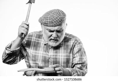 retro man repair shoes with hammer. Cobbler workmanship. shoemaker at work. mature shoemaker in workshop make shoes. shoemaker working with solve and hammer at workshop. Fashion designer at work.