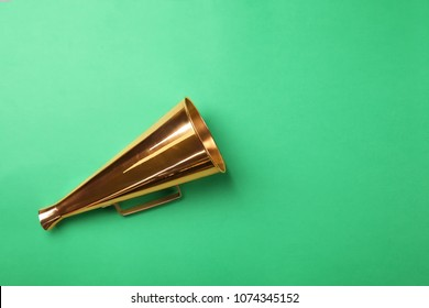 Retro megaphone on color background
