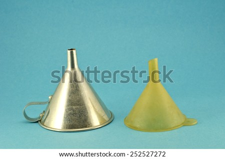 retro metal and plastic funnel hopper tool on blue background