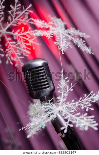 Retro microphone against colourful background. new year decor