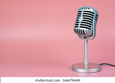 Retro microphone with copy space on pink background