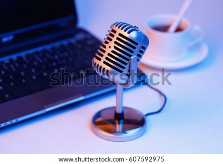 Retro microphone and notebook computer, live web cast on air concept