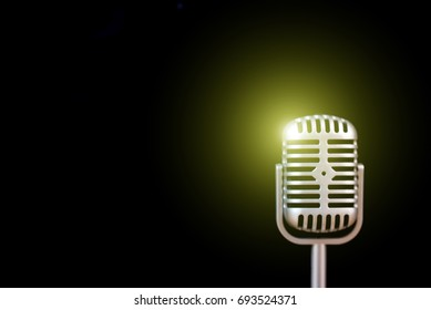 retro microphone on black background