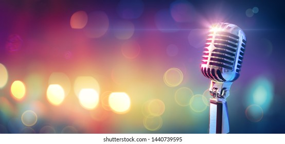 Retro Microphone On Stage With Bokeh Light