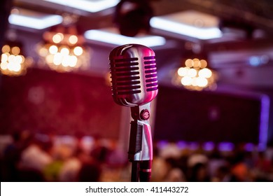 Retro microphone on stage in a pub or American Bar(restaurant) during a night show.