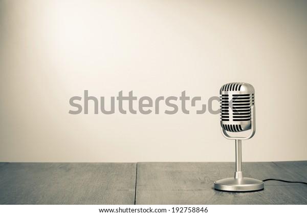 Retro microphone on table sepia photo