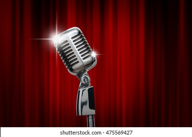 Retro microphone over the red curtain background, vintage musical concept