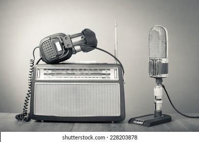 Retro microphone, radio and headphones. Vintage old style greyscale photo